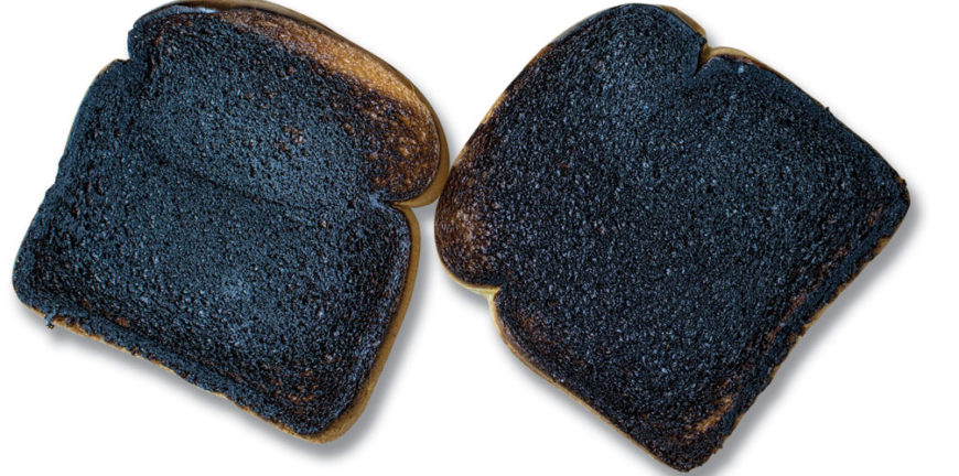 Two slices of burnt toast on a white background.